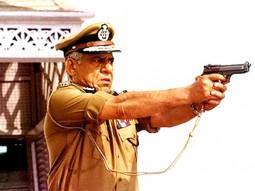 Movie Still From The Film Dev Featuring Om Puri