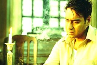 Movie Still From The Film Raincoat Featuring Ajay Devgan