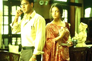 Movie Still From The Film Raincoat Featuring Ajay Devgan,Anu Kapoor