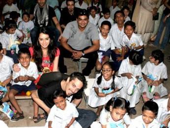 Photo Of Vaibhav Talwar,Sharadha Kapoor,Dhruv Ganesh,R Madhavan,Siddharth Kher From The Madhavan and Teen Patti cast visit NGO Kids