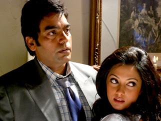 Movie Still From The Film A Strange Love Story,Ashutosh Rana,Riya Sen
