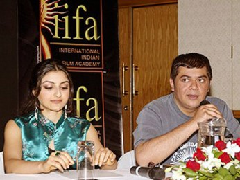 Photo Of Soha Ali Khan,Nitin Manmohan From The Dil Maange More Press Meet At IIFA,Singapore