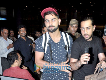 Virat Kohli snapped at the airport arriving from Delhi