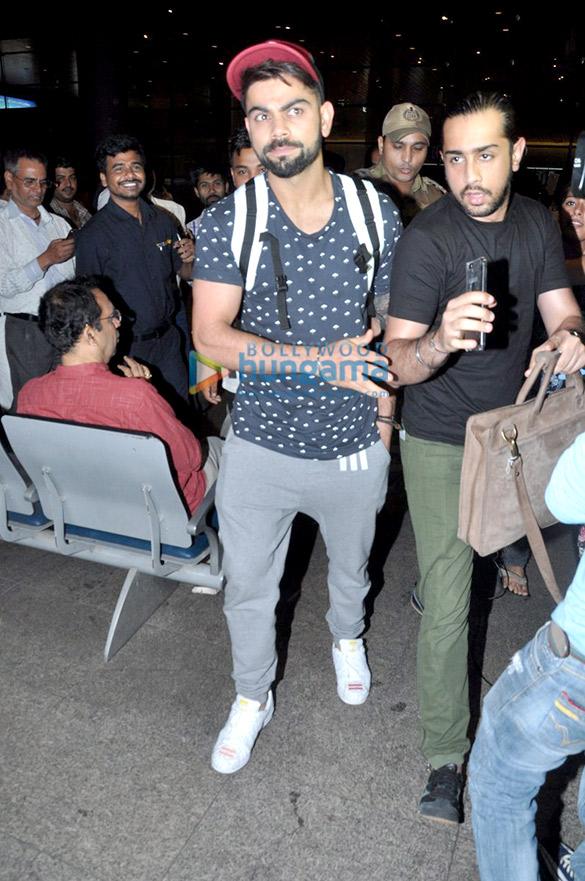 Virat Kohli snapped at the airport arriving from Delhi
