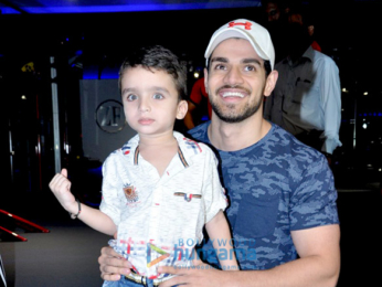 Sooraj Pancholi snapped with a kid fan at Gym launch