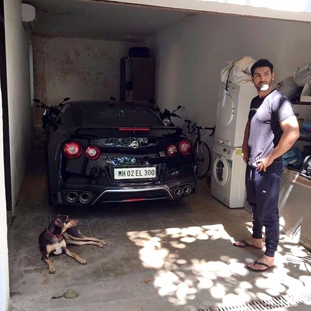 Must See John Abraham poses for a picture with his Godzilla