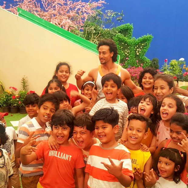 Tiger Shroff having a blast with children while shooting for Sony YAY!