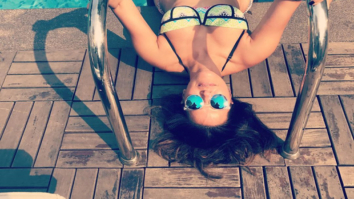 Neha Dhupia enjoys the summer in a bikini by the pool