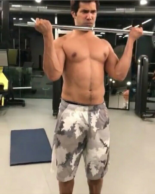 WATCH: Varun Dhawan flaunts his abs as he sweats it out in gym
