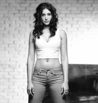 This black and white image of Nargis Fakhri