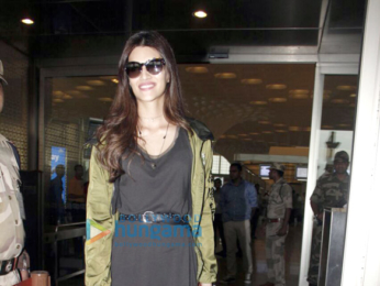 Sushant Singh Rajput and Kriti Sanon snapped at the airport leaving to attend the IIFA awards in New York