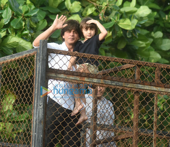 Shah Rukh Khan and Abram snapped waving and wishing fans Eid Mubarak at Mannat