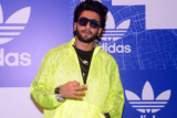 Excited Ranveer Singh climbs on the TOP of his car at the store launch of Adidas