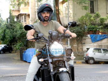 John Abraham spotted with his sports car and bike