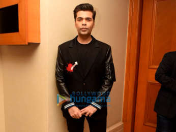 Karan Johar snapped at press meet for Ishq FM