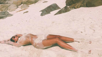 Mandana Karimi turns up the heat as she goes topless on the beach