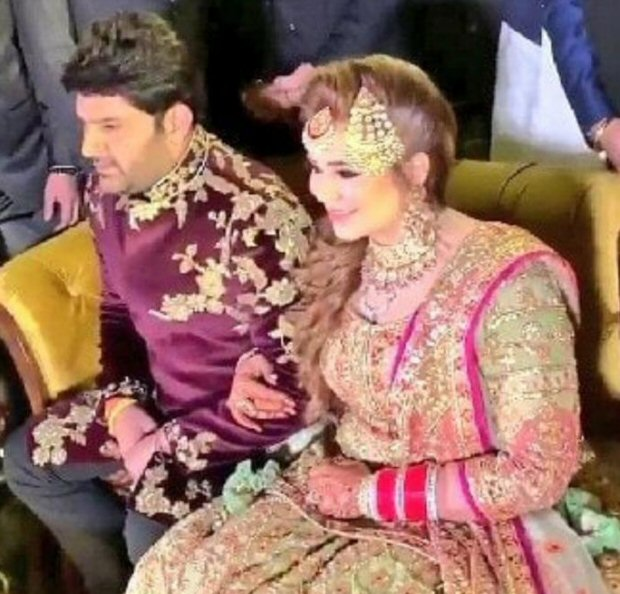 INSIDE PICS Kapil Sharma strikes a QUIRKY POSE with Ginni Chatrath at their reception