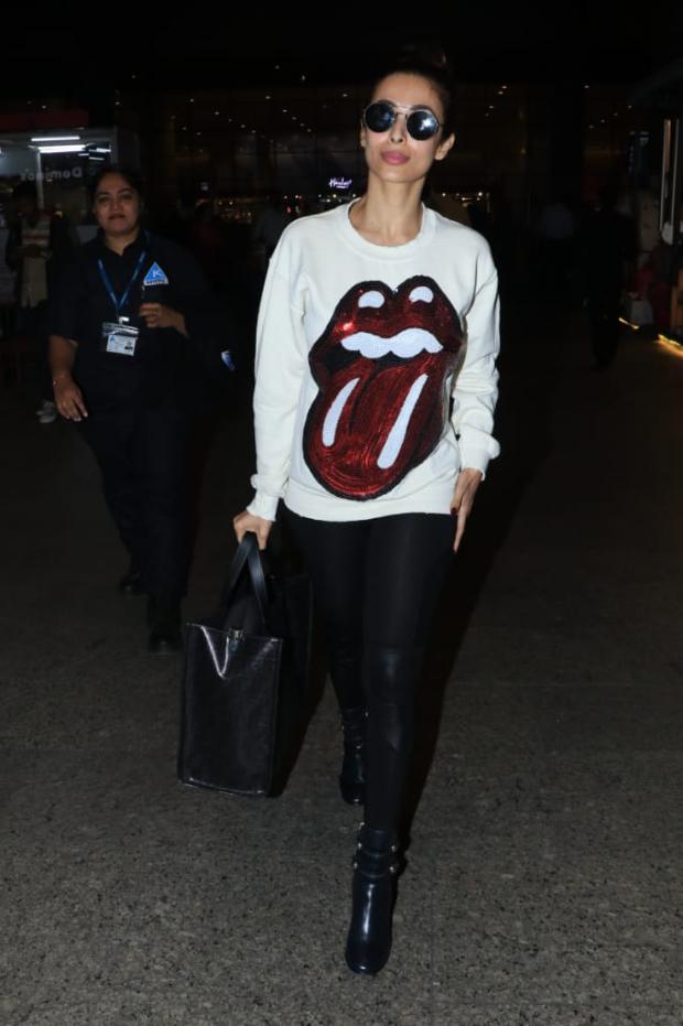 Malaika Arora in Madeworn Rolling Stones sweatshirt at the airport (2)