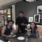 """Ever since Ranbir Kapoor and Alia Bhatt started filming Ayan Mukerji's Brahmastra, the rumors about their alleged relationship have been the talk of the town. It has been a year since they began dating while not publicly accepting it yet. But, their date nights, appearances and holidays are proof that they are enjoying their time together. While the world was celebrating Valentine's Day with their loved ones, Alia and Ranbir chose to enjoy an intimate dinner. Ranbir Kapoor accompanied Alia Bhatt for Gully Boy screening February 13. Instead of going out, the couple decided to enjoy a three-course meal during their dinner date on Valentine's Day. A well-known chef, Harsh Dixit, prepared the meal for them and shared a picture with Ranbir and Alia as they enjoyed the dessert. The two of them kept it casual instead of opting for fancy party wear. Harsh wrote, """"Happy Valentine's Day ❤️ All smiles post a #NotSoNasty 3 course valentines dinner. The menu tonight included a bunch of aphrodisiacs like red chillies, avocado, cinnamon, garlic, asparagus, truffle, salmon, chocolate, cherries, vanilla and lots of ❤️ Obviously #ZeroSugar coz #Diet."""" On the work front, Alia Bhatt is seen in Zoya Akhtar's Gully Boy starring alongside Ranveer Singh. The film is set for Valentine's Day 2019 release. She will resume shooting for Ayan Mukerji's Brahmastra soon which stars Ranbir Kapoor. The film is set for Christmas 2019 release."""