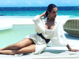 Malaika Arora sizzles in a white shirt dress as she lounges by the pool in Maldives