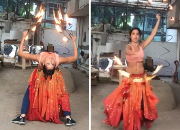 WATCH VIDEO: Nora Fatehi training with fire-hoops for 'O Saki Saki' is one video you shouldn't miss!