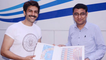 Kartik Aaryan is all smiles as he receives a customised stamp collection from Lucknow GPO!