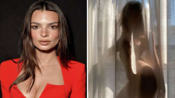 Emily Ratajkowski poses nude behind a semi-sheer curtain while self-isolating amid coronavirus pandemic