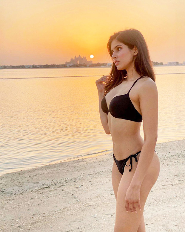 Sakshi Mallik flaunts her enviable curves in a black bikini as she poses in the backdrop of a sunset