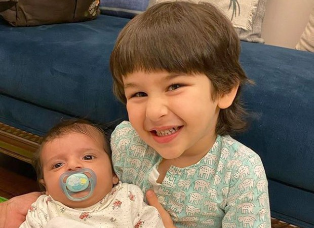 Taimur Ali Khan poses with a baby and he cannot stop smiling