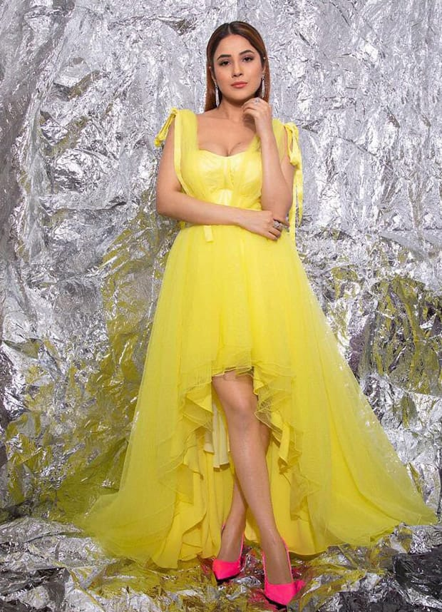 Shehnaaz Gill looks like a ray of sunshine as she shoots for her appearance on Bigg Boss 14