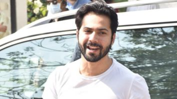Dulha Varun Dhawan arrives at the wedding venue in Alibaug dressed in a classic white t-shirt and denims