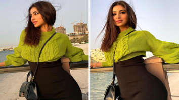Mouni Roy's mini black dress with knitted sweater is effortless style at best
