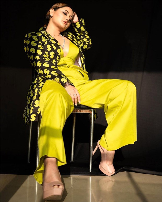 Rashami Desai looks smoking hot in plunging neckline yellow bralette and pants paired with printed blazer