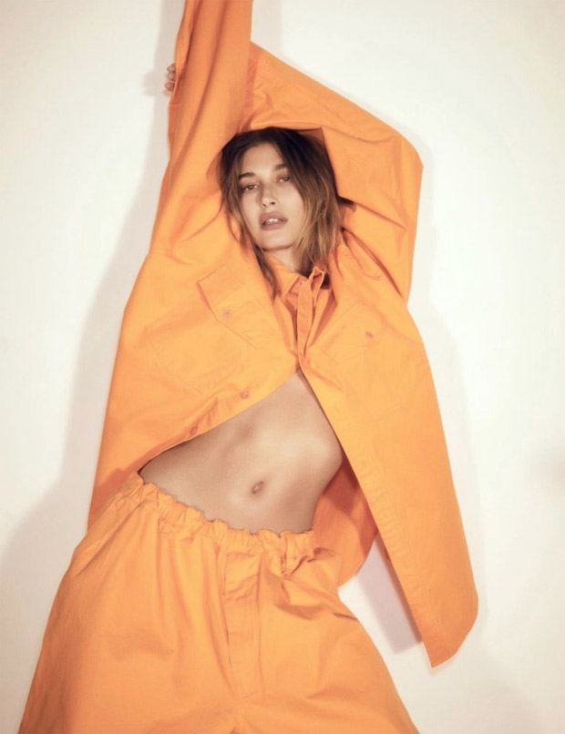 Hailey Bieber poses sensually in orange Balenciaga sweatsuit for Vogue Brasil