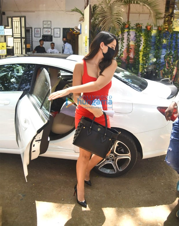 Nora Fatehi pairs red bodycon dress with Louis Vuitton bag woryh Rs. 2.32 lakh