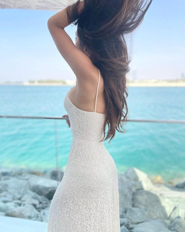 Mouni Roy looks pristine in summery strappy white midi dress