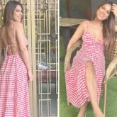 Nia Sharma opts for summer's breakout checkered print trend; dons plunging neckline and thigh-high slit maxi dress