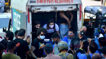 Sunny Leone and Daniel Weber snapped distributing food at Earth cafe in Bandra