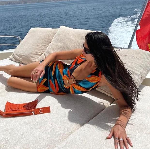 Dua Lipa sizzles in black bikini as she dives into water with boyfriend Anwar Hadid