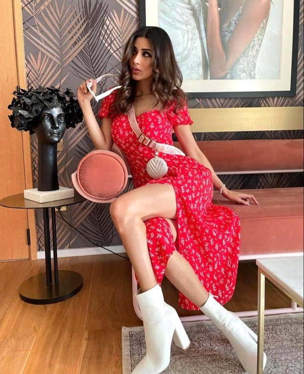 Mouni Roy pairs a red thigh-high slit midi dress with Louis Vuitton mini cross body bag worth Rs. 2.37 lakh