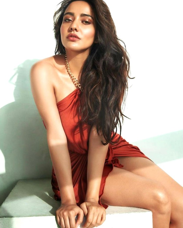 Neha Sharma exudes oomph in sultry photos, dons halter neck and thigh-high slit dress