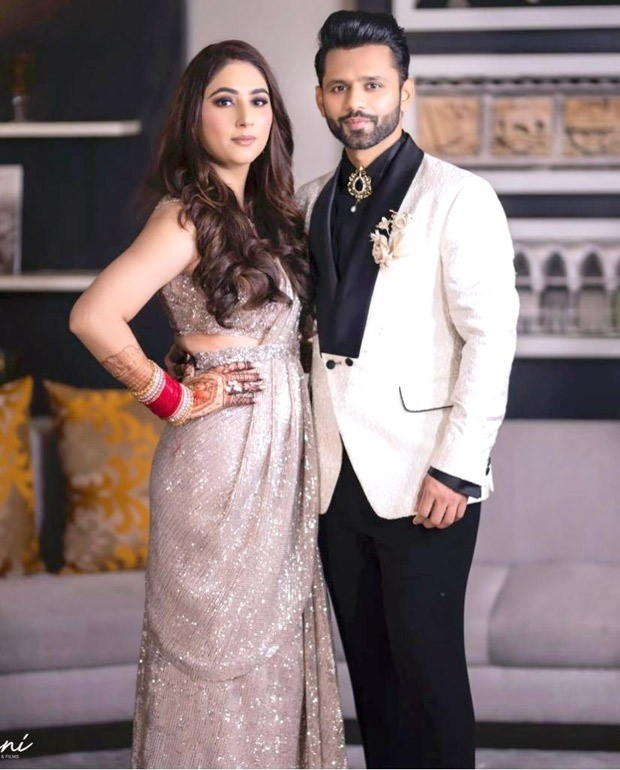 Rahul Vaidya keeps it sharp in black and white suit, Disha Parmar dons shimmery sareer from Dolly J studio for their wedding reception