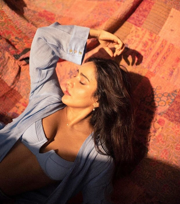 Neha Sharma shares swoon-worthy pictures in sky blue bikini top and a matching open button dress worth Rs. 17,000