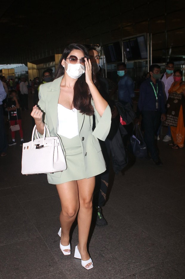 Nora Fatehi stuns at the airport in a pistachio green set with white heels and a matching white Birkin bag